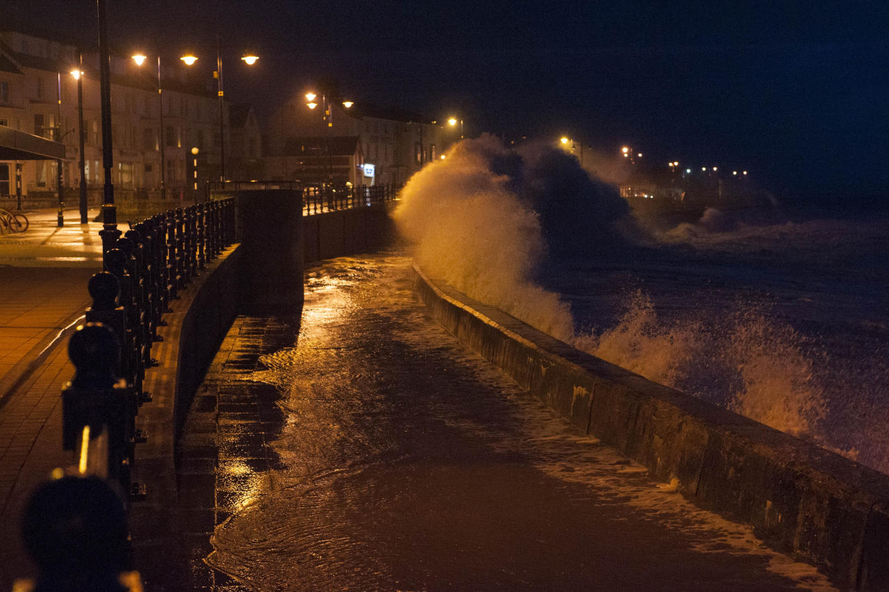 <p>The town of Porthcawl, Wales, is battered by huge waves crashing against the sea wall (SWNS) </p>
