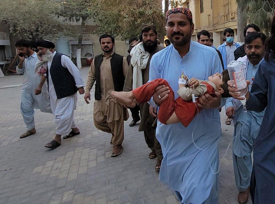 A victim of the earthquake is carried to a hospital in Quetta, Balochistan province, Pakistan (EPA)