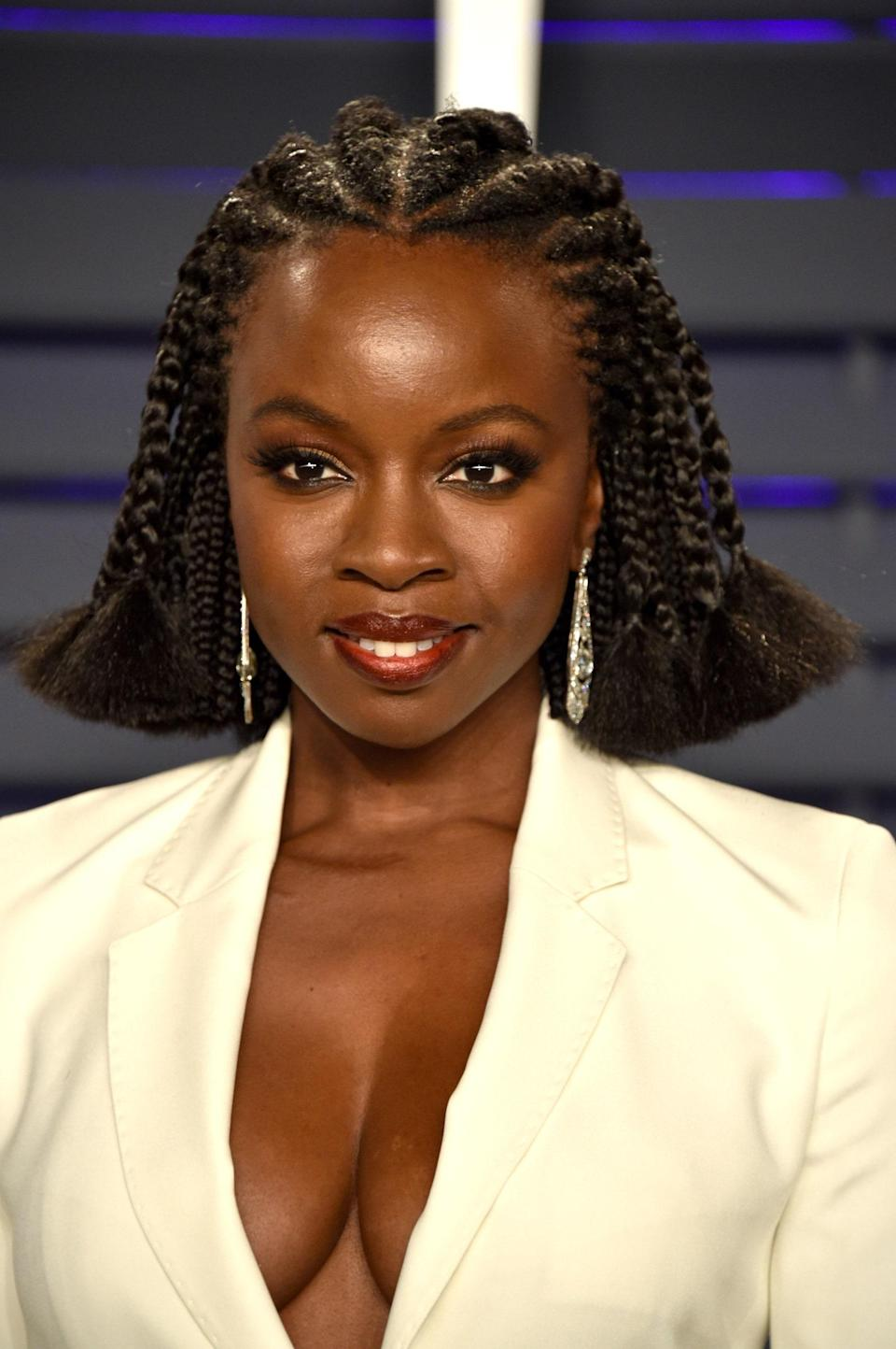 """<a href=""""https://www.glamour.com/gallery/fulani-braids-hairstyle-ideas?mbid=synd_yahoo_rss"""" rel=""""nofollow noopener"""" target=""""_blank"""" data-ylk=""""slk:Fulani braids"""" class=""""link rapid-noclick-resp"""">Fulani braids</a> don't have to be long. As Danai Gurira proves, they look incredible when they hit just above your shoulders. Flared ends make the style even cooler."""