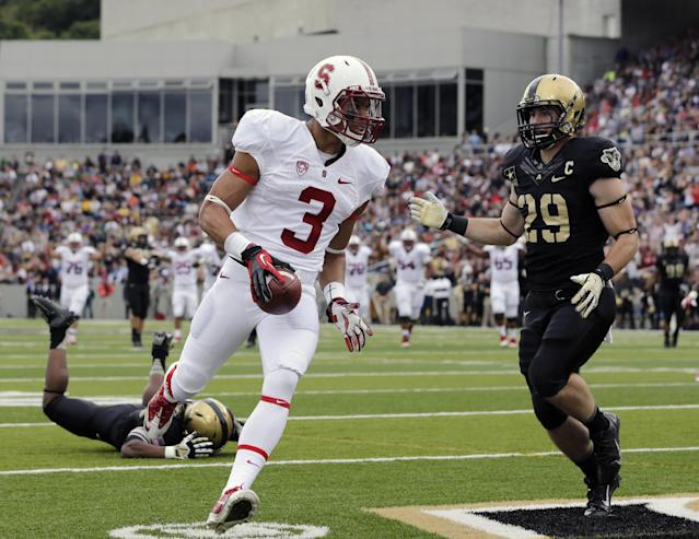 Stanford wide receiver Michael Rector (3) scores a touchdown after a reception in front of Army linebacker Thomas Holloway (29) during the first half of an NCAA college football game on Saturday, Sept. 14, 2013, in West Point, N.Y. (AP Photo/Mike Groll)