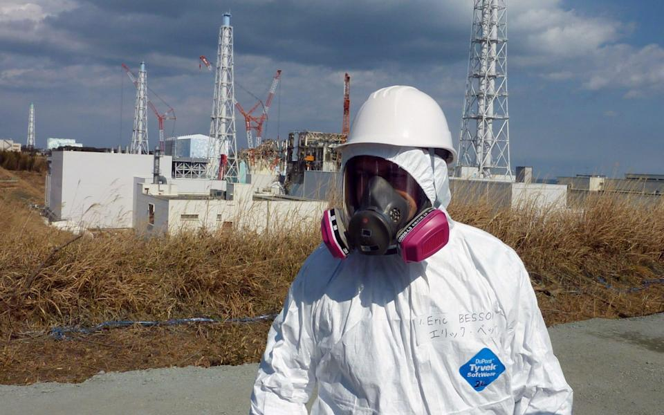 French Industry and Energy Minister Eric Besson visits the stricken Tokyo Electric Power Co. (TEPCO) Fukushima Daiichi nuclear power plant in Okuma in Fukushima - AFP