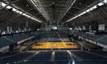 FILE - In this March 30, 2010, file photo, light shines through the windows onto the basketball court at Butler University's Hinkle Fieldhouse in Indianapolis. The NCAA announced Monday, Jan. 4, 2021, that all 67 men's basketball tournament games including the Final Four will be played entirely in Indiana in a bid to keep the marquee event from being called off for a second consecutive year because of the coronavirus pandemic. Games will be played on two courts inside Lucas Oil Stadium as well as at Bankers Life Fieldhouse, Hinkle Fieldhouse, Indiana Farmers Coliseum, Mackey Arena at Purdue and Assembly Hall in Bloomington. Only one game at a time will be played at Lucas Oil Stadium. (AP Photo/AJ Mast, File)