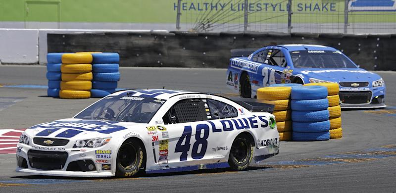 Jimmie Johnson (48) leads Jeff Gordon, right, during the NASCAR Sprint Cup Series auto race Sunday, June 22, 2014, in Sonoma, Calif
