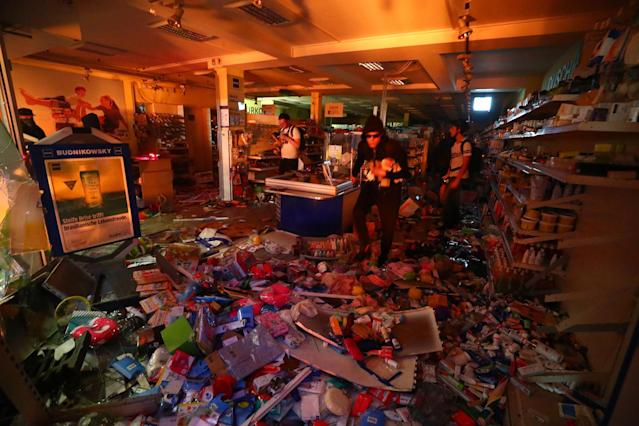 <p>A shop is looted during anti-G20 protests on the first day of the G20 summit in Hamburg, Germany, July 7, 2017. (Pawel Kopczynski/Reuters) </p>