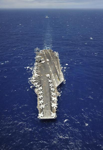 In a July 18, 2012 photo provided by the U.S. Navy, the aircraft carrier USS Nimitz (CVN 68) participates in the Great Green Fleet demonstration portion of the Rim of the Pacific (RIMPAC) 2012 exercise. Nimitz took on 200,000 gallons of biofuel in preparation for the Great Green Fleet demonstration during Rim of the Pacific (RIMPAC) 2012. Navy Secretary Ray Mabus says he thinks federal lawmakers will come around on the branch's ambitions to ease its use of foreign oil once they understand it's not an environmental move, it's a defense strategy. (AP Photo/U.S. Navy, MC3 Ryan Mayes)