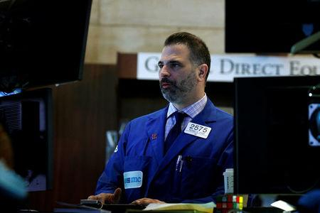 A specialist trader works at his post on the floor of the NYSE