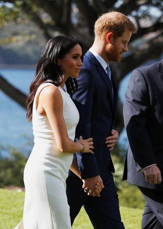 Britain's Prince Harry and wife Meghan, Duchess of Sussex walk at Admiralty House during their visit in Sydney, Australia October 16, 2018. REUTERS/Phil Noble/Pool