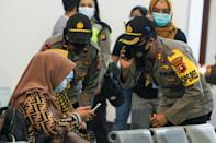 Relatives of passengers on missing Sriwijaya Air flight SJY182 wait for news at Supadio airport in Pontianak on January 9, 2021, after contact with the aircraft was lost shortly after takeoff from Jakarta