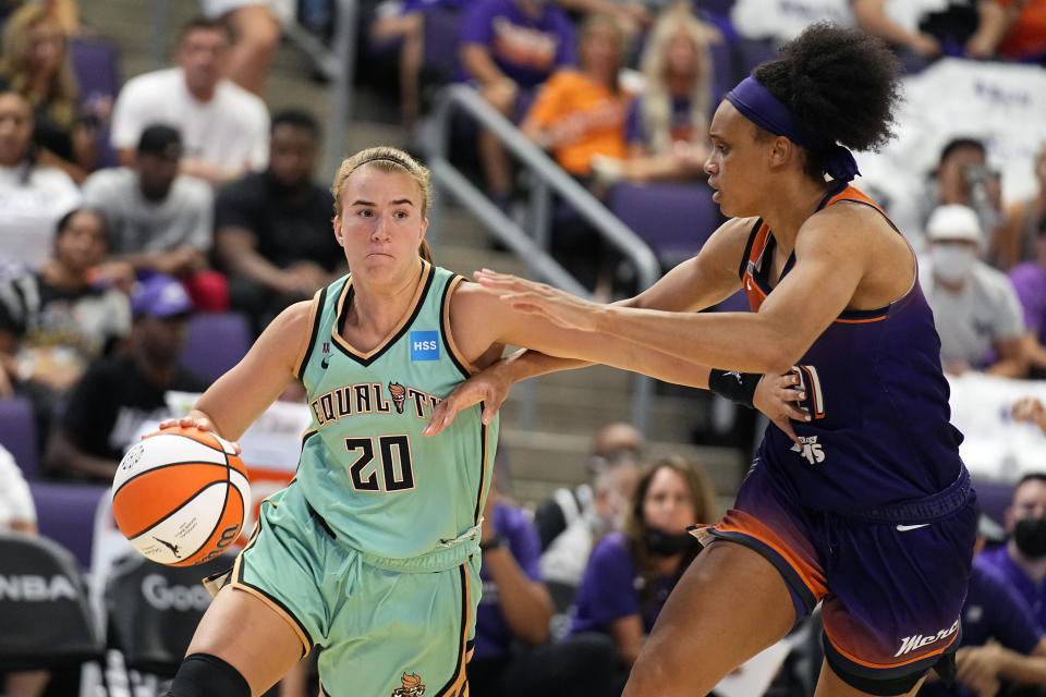 New York Liberty guard Sabrina Ionescu (20) drives on Phoenix Mercury forward Brianna Turner during the second half in the first round of the WNBA basketball playoffs, Thursday, Sept. 23, 2021, in Phoenix. Phoenix won 83-82. (AP Photo/Rick Scuteri)