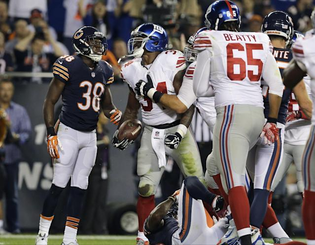 New York Giants running back Brandon Jacobs (34) gets up as he celebrates his touchdown in the first half of an NFL football game against the Chicago Bears, Thursday, Oct. 10, 2013, in Chicago. (AP Photo/Nam Y. Huh)