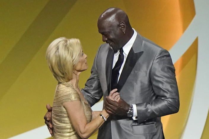 Presenter Michael Jordan, right, congratulates Kim Mulkey after Mulkey, formerly coach at Baylor and now at LSU, was enshrined with the 2020 Basketball Hall of Fame class, Saturday, May 15, 2021, in Uncasville, Conn. (AP Photo/Kathy Willens)