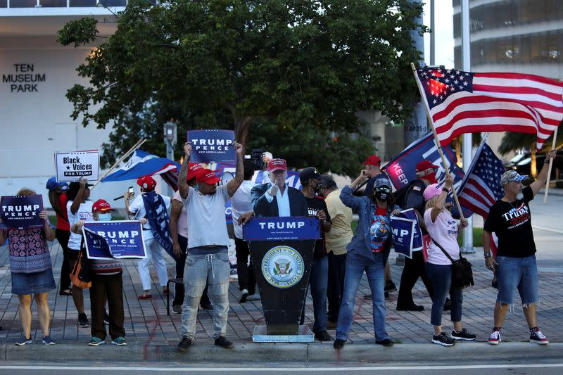Supporters of U.S. President Trump attend a gathering as Democratic U.S. presidential nominee Biden campaigns in Miami