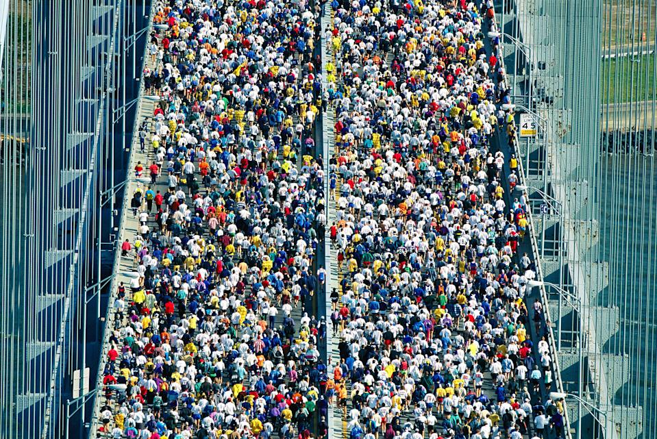 A kaleidoscopic crowd of 30,000 runners crosses the Verrazzano-Narrows Bridge in Staten Island during the New York City Marathon. Today, the marathon is the largest in the world, with 53,627 finishers in 2019.