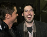 """Actor Rob Lowe, who appears in the film """"Thank You For Smoking,"""" talks to director Jason Reitman, right, as they arrive at a screening of the film at the Sundance Film Festival in Park City, Utah, Saturday, Jan. 21, 2006. (AP Photo/Carolyn Kaster)"""