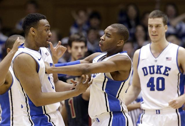 Duke's Jabari Parker, left, and Rasheed Sulaimon react following a basket as Marshall Plumlee (40) looks on during the first half of an NCAA college basketball game against Florida State in Durham, N.C., Saturday, Jan. 25, 2014. Duke won 78-56. (AP Photo/Gerry Broome)