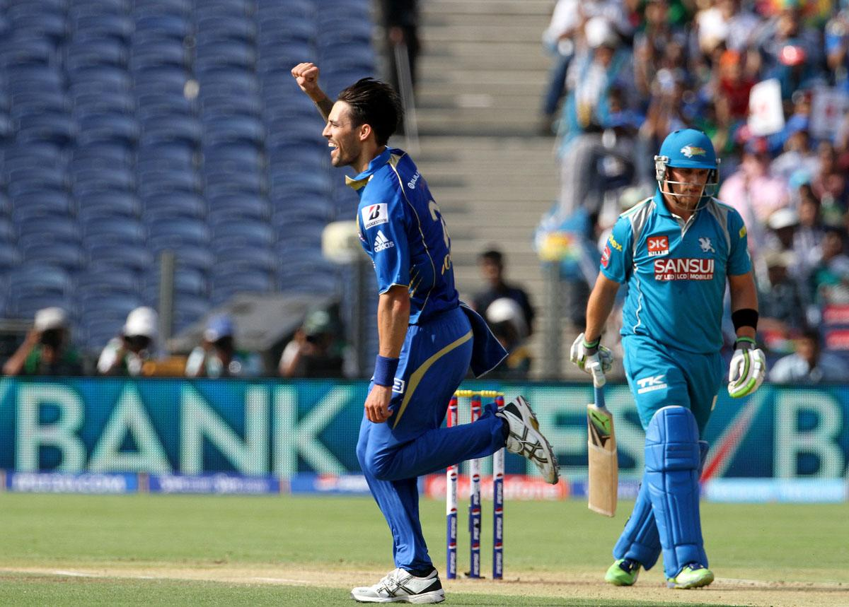 Mumbai Indian player Mitchell Johnson celebrates after getting the wicket of Pune Warriors captain Aaron Finch during match 58 of the Pepsi Indian Premier League ( IPL) 2013  between The Pune Warriors India and the Mumbai Indians held at the Subrata Roy Sahara Stadium, Pune on the 11th May 2013. (BCCI)