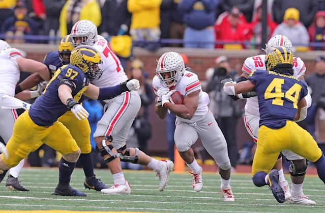 Ohio State RB J.K. Dobbins rushed for 211 yards and four scores against Michigan. (Photo by Leon Halip/Getty Images)