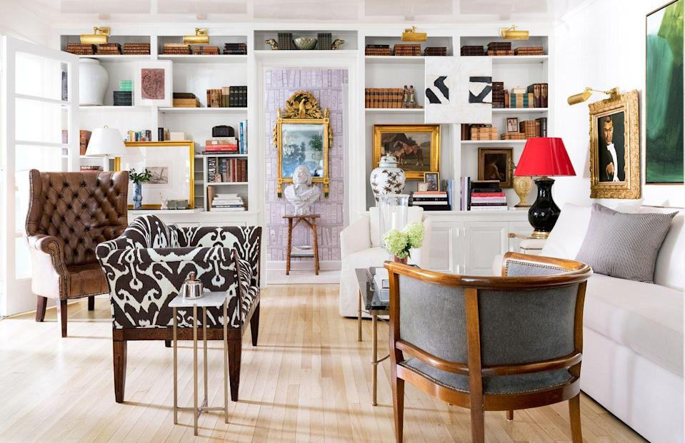 """<p>Wow. Now this is how you decorate open shelves. Covered in a fresh coat of paint to blend in with the surrounding walls, the whole room feels more open and spacious. Interior designer Shaun Smith put some antique books on display and also created visual intrigue by hanging artwork over the wall between the shelves. </p><p><em><a href=""""https://www.housebeautiful.com/design-inspiration/house-tours/g15947887/shaun-smith-house-tour/"""" rel=""""nofollow noopener"""" target=""""_blank"""" data-ylk=""""slk:See more at House Beautiful »"""" class=""""link rapid-noclick-resp"""">See more at House Beautiful »</a></em></p><p><strong>What you'll need: </strong>White paint, $26, <a href=""""https://www.amazon.com/Rust-Oleum-332120-Simply-Semi-Gloss-Interior/dp/B07CBNBPG2/ref=sr_1_36?keywords=white+paint+interior&qid=1553275286&s=gateway&sr=8-36&tag=syn-yahoo-20&ascsubtag=%5Bartid%7C10063.g.36078080%5Bsrc%7Cyahoo-us"""" rel=""""nofollow noopener"""" target=""""_blank"""" data-ylk=""""slk:Amazon.com"""" class=""""link rapid-noclick-resp"""">Amazon.com</a></p>"""