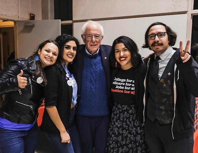 Jewel Hurtado, 21, second from right, with Sen. Bernie Sanders.