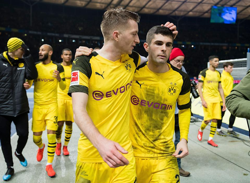 BERLIN, GERMANY - MARCH 16: Marco Reus and Christian Pulisic of Borussia Dortmund celebrate the win after the final whistle during the Bundesliga match between Hertha BSC and Borussia Dortmund at the Olympiastadion on March 16, 2019 in Berlin, Germany. (Photo by Alexandre Simoes/Borussia Dortmund/Getty Images)