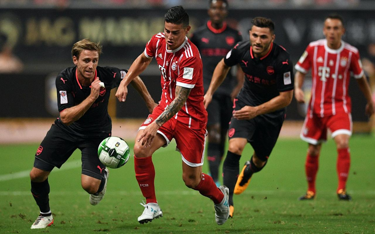"Arsenal finally got the beating of Bayern Munich, albeit in the surroundings of a pre-season friendly in Shanghai. Alex Iwobi grabbed a last-gasp equaliser for Arsene Wenger's side by heading past Christian Früchtl in normal time to send the International Champions Cup into penalties. Iwobi, one of a number of second-half substitutes, then scored in the shoot-out while Nacho Monreal and Aaron Ramsey were also on target. Renato Sanches struck the bar with his effort while Juan Bernat saw his saved by Emiliano Martinez to ensure Arsenal of a 3-2 win on penalties. Bayern Munich, who had beaten Arsenal 5-1 on two occasions in the Champions League last season, looked like causing Arsenal further problems when they took an early lead with a Robert Lewandowski penalty after nine minutes. Arsenal celebrate after winning the International Champions Cup The Bundesliga champions would have added to their lead were it not for the brilliance of Petr Cech. Arsenal's record-signing Alexandre Lacazette had a great chance to level midway midway through the first half but saw his effort saved well by Bayern keeper Tom Starke. A raft of substitutions disrupted the flow of the contest in the second half but Iwobi impressed in his cameo role as Arsenal went on to lift the trophy. Arsenal will next face Chelsea this Saturday, July 22 at the Bird's Nest Stadium in Beijing. 3:05PM Arsenal win 3-2 on pens Sorry for the delay, but for technical issues meant we weren't able to bring you the penalties live. What I can say is that Arsenal have won 3-2 with Ramsey, Monreal and Iwobi all on target for Wenger's side. Elneny was the only player to miss with Früchtl guessing the right way. Sanches and Bernat both missed their efforts for Bayern. Sanches powered his shot onto the bar while Martinez saved from Bernat to ensure Arsenal of the three points in the first match of the International Champions Cup. 2:30PM But wait, there's more. There are penalties We are not done yet people. 2:26PM FT Arsenal 1 Bayern 1 There's only time for Bayern to restart the game before the ref blows up. After conceding 15 goals in their last three clashes with the German giants, Arsenal got lucky at the end. It's only a pre-season friendly but the scoreline will give them confidence. Iwobi's header was their only shot on target in the second half. 2:24PM 90 mins + 3  GOAL!! Arsenal 1-1 Bayern But wait. There's drama at the death as Arsenal break clear, Ramsey dinks a ball into the middle and Iwobi plants his header past Früchtl! 2:21PM 90 mins + 2 Four minutes of stoppage time to be played as Bayern build form the back again through Hummels. Dorsche dribbles to the edge of the area, but Willock blocks his route through.  2:20PM 88 mins Sanches shows a touch of class by scooping a ball up and into the path of Bernat who charges in on goal from an acute angle. Bernat gets away from Maitland Niles, but Monreal is on hand to clear Arsenal's line. 2:16PM 86 mins Nelson has impressed in the right wing back, right full-back role. He's stayed disciplined this half and looked good going forward.  2:14PM 84 mins Walcott earns a free-kick just inside the Bayern half. Hummels kicks the ball away trying to bide the Bundesliga giants some time. The set-piece is taken but Arsenal are struggling to link up and Willock collects a booking for a lashing out at Dorsche.  2:10PM 79 mins Walcott puts his sprinting boots on, gets away from his man but is curling shot from the outside of his boot is easily dealt with by Frucht. That's the first time Bayern's substitute keeper has got his hands on the ball. 2:06PM 75 mins The changes to both sides have affected the flow of the friendly (as they always do). Sanches is trying to pull the strings for Bayern in the middle of the park but the ball goes out of play and Bayern prepare to make three more changes. Dorsch, Gotze and Friedl all come on with Ribery among others departing and another drinks break is taken. The intensity of the first half is a distant memory.  2:02PM 71 mins Another change: Cech comes off to a rapturous applause as Martinez takes his place. 2:01PM 69 mins Clever play from Nelson draws a foul from Pantovic down the right flank just outside the area. The 18-year-old will send over the set-piece but it's headed clear by Hummels. Nelso goes again, taking on Ribery and Bayern emerge with the ball as it bounces off the legs of Maitland Niles and out of play. 1:55PM 65 mins More subs: Lewandowski and James off, Pantovic and Wintzheimer on. 1:55PM 64 mins Iwobi shows great persistence and strength to win a free-kick with three Bayern bodies surrounding him. Maitland Niles whips in the set-piece but it's too high and long and Ramsey scampers to collect out wide. The ball is played long with Ribery bursting down the middle. Cech is out in a flash again to clear the danger. He was a full 35 yards off his line. 1:52PM 62 mins Arsenal yet to settle since all those four changes at the break. Wenger and Vic Akers are at the top of Arsenal's technical area having wild discussions. They will make another change, Ramsey replaces Xhaka. 1:49PM 59 mins Elneny finds himself in a spot of bother, the ball out of his reach. Elneny stretches and makes contact with Tolisso and earns himself a booking. It's a little unfair on Elneny who played the ball first but caught the Bayern man on his follow-through.  1:45PM 54 mins Ribery is rolling around on the sidelines receiving treatment following the effects of a heavy challenge from Maitland Niles. The Arsenal youngster arguably made a harder challenge on Bernat in the first half and was punished. Nothing doing this time.    1:44PM 53 mins Bramall shows a clean pair of heels to Hummels and gets past the German stalwart but his centre is mopped up in the middle.  1:40PM 49 mins Arsenal exposed down their left flank again as Lewandowski can't quite reach a centre from sub Coman. The Pole almost let the ball run on to James but the Colombian doesn't get a clean strike on the ball.  1:38PM 47 mins Arsenal have switched to a back four after being up against it in the first half. Welbeck looks to be the lone striker following the withdrawals of Lacazette and Ozil. 1:37PM Subs at the ready Iwobi, Walcott, Bramall and Willock all on for Arsenal. Ozil, Coquelin, Lacazette and Bielik all go off.   Meanwhile, Frucht, Friedl and Sanches all come on for Bayern's Starke, Muller and Martinez. 1:20PM HT Arsenal 0-1 Bayern The whistle goes and Arsenal have been thankful for the saves of Cech during the first 45. Lacazette had a great chance to draw Wenger's side level but Starke showed great agility to deny the Frenchman of a second goal in an Arsenal shirt since his record-breaking move. Wenger, meanwhile, has been sporting his snazzy Arsenal trainers on the sidelines. Arsene Wenger's new Arsenal trainers. pic.twitter.com/y4udBqs91C— Arsenal News (@ArsenalFC_fl) July 19, 2017   1:18PM 45 mins + 1 Two minutes of stoppage time at the end of the first half. Bielik keeps possession for Arsenal deep in the corner and they try and make progress down the right flank. Welbeck wins a challenge and they build from the back again. But it's Bayern who click through their gears as soon as they get on the ball. Ribery lays off the ball with the outside of his right boot but Xhaka clears the danger.  1:15PM 43 mins Arsenal make a change, Nelson coming on for Kolasinac. Not clear whether an injury was behind the early switch or for Kolasinac's lack of awareness in tracking James. 1:13PM 42 mins James is unmarked, looming on the edge of the area and finally Ribery picks his team-mate out. He brings it down with the outside of his left boot and shapes to shoot but Cech is onto the danger in a flash. 1:10PM 39 mins Cech again to the rescue, this time to deny Bernat. Maitland-Niles shows too much space to Ribery who gets to the byline, pulls back for Bernat whose effort is palmed away by the former Czech international.  1:08PM 37 mins Cech reacts well to a deflected Muller strike to flick the ball round the post for a corner. Muller's effort was heading one direction before catching the heel of Elneny but the 35-year-old keeper responded well. 1:06PM 35 mins Welbeck latches on to a loose ball, he chests it down but couldn't get his arm out of the way. The eager ref isn't going to let that go.  1:02PM 32 mins Lacazette is through! The Frenchman looks set to bury the ball, but his low effort is saved by Starke and it goes out for a corner. 1:00PM 29 mins Good slow build up from Arsenal as they work their way to the box but then Lacazette loses out to Hummels. The players then break for a drinks break on the half hour mark. Ancelotti is very animated on the sidelines with his side. Wenger, less so, in fact the players are walking away from their manager. 12:55PM 24 mins  Martinez also in the book for Bayern for something that happened off the ball. Arsenal starting to win more possession and have more cohesion in midfield but Bayern continue to break quickly and with intent against an inexperienced back three. James in action for Bayern   12:53PM 21 mins  Let off for Arsenal! Muller has yards of space to head down into the path of Tolisso who finishes well but the flag is up. A look at a reply shows the linesman got it wrong. 12:50PM 20 mins Lacazette finally gets time on the ball, but loses possession. Arsenal win it back but then Xhaka passes straight to Ribery. Coquelin goes in late on the Frenchman and collects the first yellow of the match. 12:48PM 18 mins Arsenal trying to slow the pace down. Monreal and Kolsinac link up down the left and play in Ozil. The German tries to dribble through Bayern's rearguard but is faced with a brick wall. 12:47PM 15 mins Men against boys early doors again as Ribery swaggers through Arsenal's new back three. He pulls the ball back in the middle, but there's no-one in a red shirt bursting into the box. 12:42PM 12 mins Ozil latches on to a ball over the top from Welbeck. The German international makes a fantastic run and catches the ball on the volley but strikes straight at Starke.  12:40PM 9 mins - Arsenal 0-1 Bayern (Lewandowski pen) Lewandowski sends Cech the wrong way with a comfortable side-foot into the top right-hand corner. It seemed a tad harsh of the ref to award the penalty. Maitland-Niles was just slightly off the pace and got caught out by Bernat. Our no. 9️⃣ in the 9️⃣th minute! #FCBARS@lewy_official#AudiFCBTour 1-0 pic.twitter.com/HcaWDyifrl— FC Bayern English (@FCBayernEN) July 19, 2017   12:39PM 8 mins - Bayern penalty Maitland-Niles is punished for a foul on Bernat.  12:38PM 8 mins First move for Arsenal into the final third as Welbeck finds space and lays the ball off to the on-rushing Xhaka. He lets fly from the edge of the area but it sails over the bar. 12:36PM 6 mins Kolasinac goes it alone down the left flank but runs into trouble and Bayern break again. Ribery faces space close to the byline and delivers a ball to the back post where James is lurking. The Colombian brings the ball down on his chest, but shoots into the side-netting. A first opening for Bayern.  12:34PM 3 mins Ozil looks to be playing down the right channel, is held off easily by Bernat. Now the back-three of Elneny, Monreal and Bielik are given their first workout as a long ball forward deceives Elneny. They finally clear their lines. 12:32PM 1 min James Rodriquez, in his first start for Bayern, gets a feel for things as Bayern dominate possess straight from kick-off with some slick passing. Arsenal have barely got a foot on the ball. They finally win possession when Lewandowski is offside. 12:30PM Arsenal in the dark Or more to the point, in all-black with a Chinese logo taking the place of their usual sponsors on the front of their jersey. Bayern are in their standard all-red with thin white strips attire.  @FCBayernEN & @Arsenal on the pitch in Shanghai. #ICC2017pic.twitter.com/eafFoG5s3W— Dan Ogunshakin (@DanOgunshakin) July 19, 2017   12:28PM The teams are out We understand that the delay was due to Bayern arriving at the stadium a little later than planned. The excited Chinese fans in the stands don't seem to be too bothered by the hold up as they frantically wave their Arsenal and Bayern merchandise. Everyone seems to be kitted out in a replica shirt too. It's a sea of red out there.  12:18PM Hold up Lots of people coming through the turnstiles at the 58,000-capacity Shanghai Stadium. It looks like it's not going to get underway on time. We're still awaiting the teams.  12:15PM Late change to Arsenal line-up Mohamed Elneny replaces Per Mertesacker who has been forced to pull out of the friendly with illness. One late change to our starting lineup @mertesacker drops out through illness, to be replaced by @ElNennyMpic.twitter.com/LTHQ7ot7vU— Arsenal FC (@Arsenal) July 19, 2017   12:12PM What role for Lacazette today? Lacazette has been given a gentle welcome to life at Arsenal, playing out wide during the Australia leg of the pre-season tour so far. Could today be the first time that Wenger throws the Frenchman down the middle? Wenger could opt to play their record-signing as a lone striker with Ozil and Welbeck out wide. Alternatively, he could decide to play Lacazette just off Welbeck. Lacazette scored against Sydney FC last week 12:03PM Mahrez reminds Arsenal of his talents While Arsenal are out in China, target Riyad Mahrez has reminded Wenger of his talents with a great solo goal from just outside the box for Leicester in their pre-season friendly against West Brom. Mahrez hits back for Leicester! #LCFCpic.twitter.com/r78vqm3gEJ— G (@SimplySmithies) July 19, 2017 Mahrez is said to be holding out for a move to Arsenal this summer. Wenger, however, seems to be prioritising Monaco winger Thomas Lemar before turning his attentions elsewhere. 11:47AM Sanchez going nowhere? Arsene Wenger gave his clearest indication this summer that Arsenal will refuse to sell Alexis Sanchez. You can't blame Arsenal fans for fearing the worst and for a feeling of deja vu. Wenger previously allowed sell Samri Nasri and Robin van Persie to leave rather than let them enter the final year of their contracts – but he is adamant that the Sanchez situation is different. ""Every case is different, Van Persie was going from 30 to 31, when he left he had one year on his contract, Sanchez is younger,"" Wenger said yesterday. Sanchez is currently on holiday after playing for Chile at the Confederations Cup earlier this month. Alexis Sanchez was the only player to reach double figures for goals & assists in the Premier League last season. 24 goals ⚽️ 10 assists ��️ pic.twitter.com/P8fatwAvpB— Squawka Football (@Squawka) July 18, 2017 11:30AM And Bayern's starting XI Here's our team to face @Arsenal! Kick-off at 13:20 CEST. ��#AudiFCBTour#FCBARS#ICCSG#packmas ����️ pic.twitter.com/8iK7vUspbL— FC Bayern English (@FCBayernEN) July 19, 2017   11:22AM How Arsenal line-up Arsenal start with three at the back, but there's no place in the starting line-up for Giroud. But  Ozil and record-signing Lacazette will link up for the first time.  Our team to play @FCBayern: Cech, Bielik, Mertesacker, Monreal, Maitland-Niles, Coquelin, Xhaka, Kolasinac, Ozil, Welbeck, Lacazette— Arsenal FC (@Arsenal) July 19, 2017   11:21AM Match preview Arsenal begin the Chinese leg of their pre-season tour with a match against Bundesliga champions Bayern Munich this lunch time (kick-off 12.20pm). Arsene Wenger's side have conceded 15 goals to the German giants in their last three encounters with their rivals, two of which came in last season's Champions League. But, having signed a new contract at the end of the season, Wenger heads into today's friendly and the season ahead with renewed hope. The International Champions Cup provides Arsenal with a sterner test of their ability following a sedate tour of Australia (where they collected two wins in three days), as they also take on Chelsea in three days' time. Arsenal will also face Benfica (July 29) and Sevilla (July 30) in the Emirates Cup as they build up to their Premier League opener against Leicester on Friday, August 11."
