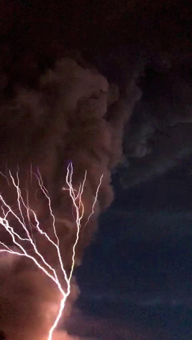 Forks of lighting were seen alongside the spewing ash of the Taal volcano in the Philippines (Picture: SWNS)