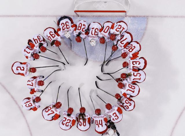 <p>Russian athlete Nadezhda Morozova (92) huddles with teammates after the quarterfinal round of the women's hockey game against Switzerland at the 2018 Winter Olympics in Gangneung, South Korea, Saturday, Feb. 17, 2018. The team from Russia won 6-2. (AP Photo/Frank Franklin II) </p>