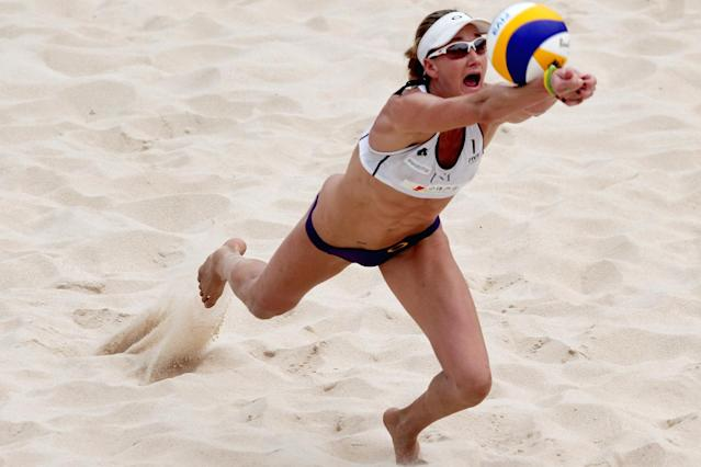 Kerri Walsh (L) of the United States hits the ball during the Women's 1/4 final matches at the 2011 Swatch World Tour Beijing Grand Slam in Chaoyang Park on June 11, 2011 in Beijing, China.
