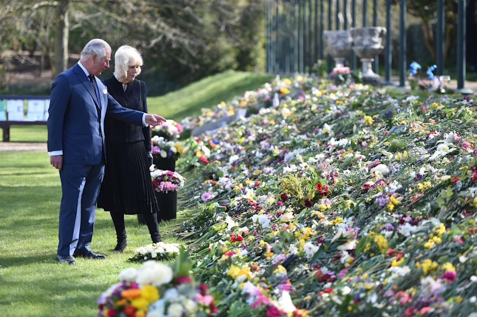 Prince Charles and the Duchess of Cornwall looking at flora tributes to the Duke of Edinburgh (Jeremy Selwyn)