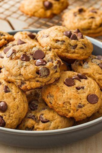 """<p>As soon as October hits, there's no regular chocolate chip cookies in the Delish kitchen. Adding <a href=""""https://www.delish.com/uk/cooking/recipes/a32470725/healthy-pumpkin-muffins-recipe/"""" rel=""""nofollow noopener"""" target=""""_blank"""" data-ylk=""""slk:pumpkin"""" class=""""link rapid-noclick-resp"""">pumpkin</a> puree and <a href=""""https://www.delish.com/uk/cooking/recipes/a33529987/easy-pumpkin-cake-recipe/"""" rel=""""nofollow noopener"""" target=""""_blank"""" data-ylk=""""slk:pumpkin pie spice"""" class=""""link rapid-noclick-resp"""">pumpkin pie spice</a> upgrades our basic <a href=""""https://www.delish.com/uk/cooking/recipes/a28829642/chocolate-chip-cookies-recipe/"""" rel=""""nofollow noopener"""" target=""""_blank"""" data-ylk=""""slk:chocolate chip cookie"""" class=""""link rapid-noclick-resp"""">chocolate chip cookie</a> dough into an amazing Autumnal dessert. These will be a hit at any <a href=""""https://www.delish.com/uk/cooking/recipes/g30220794/cookie-recipes/"""" rel=""""nofollow noopener"""" target=""""_blank"""" data-ylk=""""slk:bake sale"""" class=""""link rapid-noclick-resp"""">bake sale</a> or dinner party. </p><p>Get the <a href=""""https://www.delish.com/uk/cooking/recipes/a33749990/pumpkin-spice-chocolate-chip-cookies-recipe/"""" rel=""""nofollow noopener"""" target=""""_blank"""" data-ylk=""""slk:Pumpkin Chocolate Chip Cookies"""" class=""""link rapid-noclick-resp"""">Pumpkin Chocolate Chip Cookies</a> recipe.</p>"""