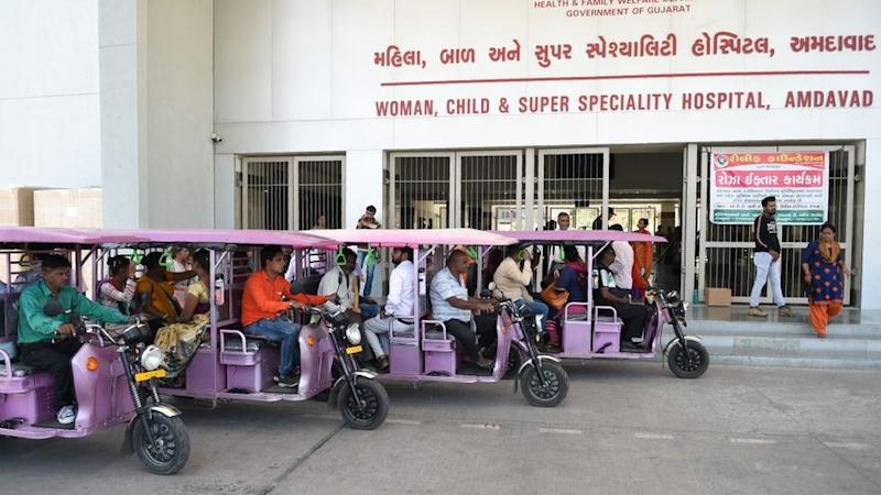 e-rickshaws parked outside a Gujarat hospital