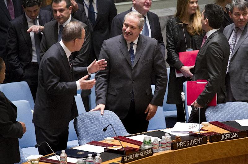 Jordanian Foreign Minister Nasser Judeh , center, speaks with U.N. Secretary-General Ban Ki-moon before a meeting of the United Nations Security Council at U.N. headquarters, Monday, Jan. 20, 2014. (AP Photo/Craig Ruttle)