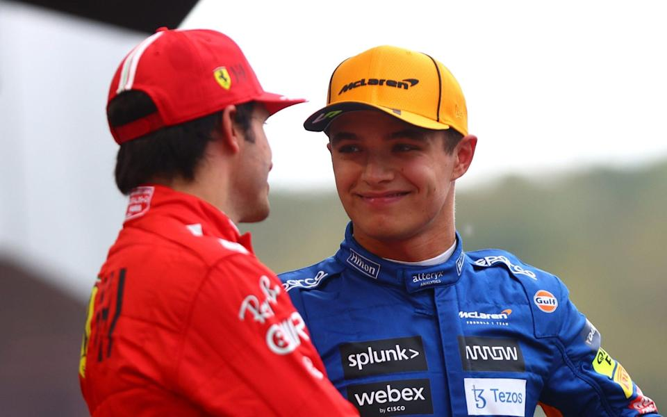 Pole position qualifier Lando Norris of Great Britain and McLaren F1 talks with second place qualifier Carlos Sainz of Spain and Ferrari in parc ferme during qualifying ahead of the F1 Grand Prix of Russia at Sochi Autodrom on September 25, 2021 in Sochi, Russi - Dan Istitene - Formula 1/Formula 1 via Getty Images