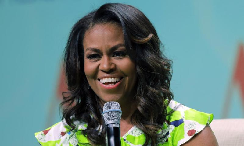 "FILE - In this June 22, 2018 file photo, former first lady Michelle Obama speaks at the American Library Association annual conference in New Orleans. Obama is launching a book tour to promote her memoir ""Becoming,"" a tour featuring arenas and other performing centers to accommodate crowds likely far too big for any bookstore. (AP Photo/Gerald Herbert)"