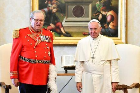 FILE PHOTO: Pope Francis meets Robert Matthew Festing, Prince and Grand Master of the Sovereign Order of Malta during a private audience at the Vatican