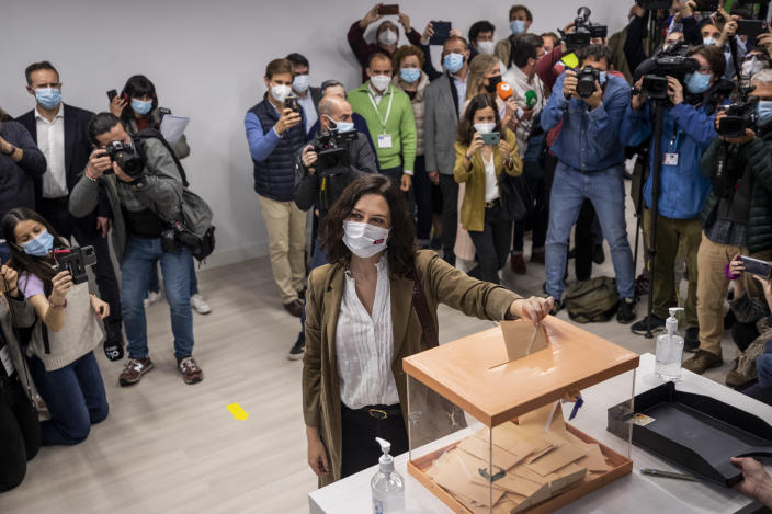 The incumbent conservative Madrid president Isabel Diaz Ayuso casts her vote during the regional election in Madrid, Spain, Tuesday, May 4, 2021. Over 5 million Madrid residents are voting for a new regional assembly in an election that tests the depths of resistance to lockdown measures and the divide between left and right-wing parties. (AP Photo/Bernat Armangue)