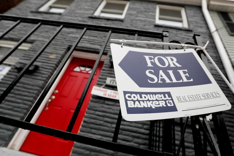 FILE- This Jan. 4, 2019, file photo shows a house for sale in Pittsburgh's Lawrenceville neighborhood. On Thursday, Jan. 31, Freddie Mac reports on this week's average U.S. mortgage rates. (AP Photo/Keith Srakocic, File)