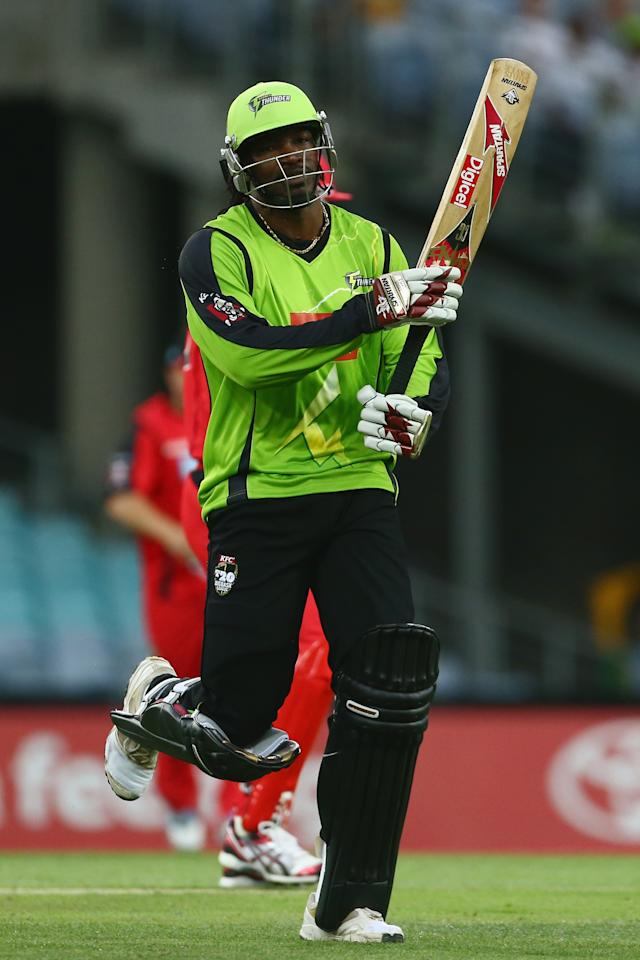 SYDNEY, AUSTRALIA - DECEMBER 14:  Chris Gayle of the Thunder reacts after being run out during the Big Bash League match between the Sydney Thunder and the Melbourne Renegades at ANZ Stadium on December 14, 2012 in Sydney, Australia.  (Photo by Mark Kolbe/Getty Images)