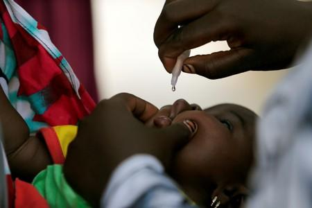 FILE PHOTO: A child is given a dose of polio vaccine at an immunisation health centre in Maiduguri, Borno State, Nigeria, in August 2016
