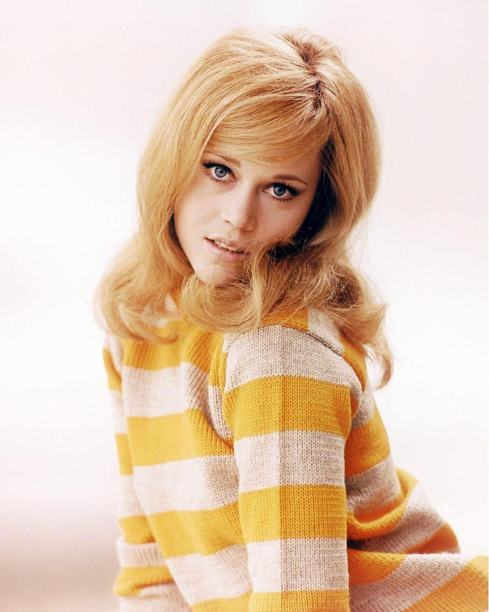 <p>A teenage Jane Fonda poses in a yellow and white striped sweater and classic 1960's hairdo.</p>