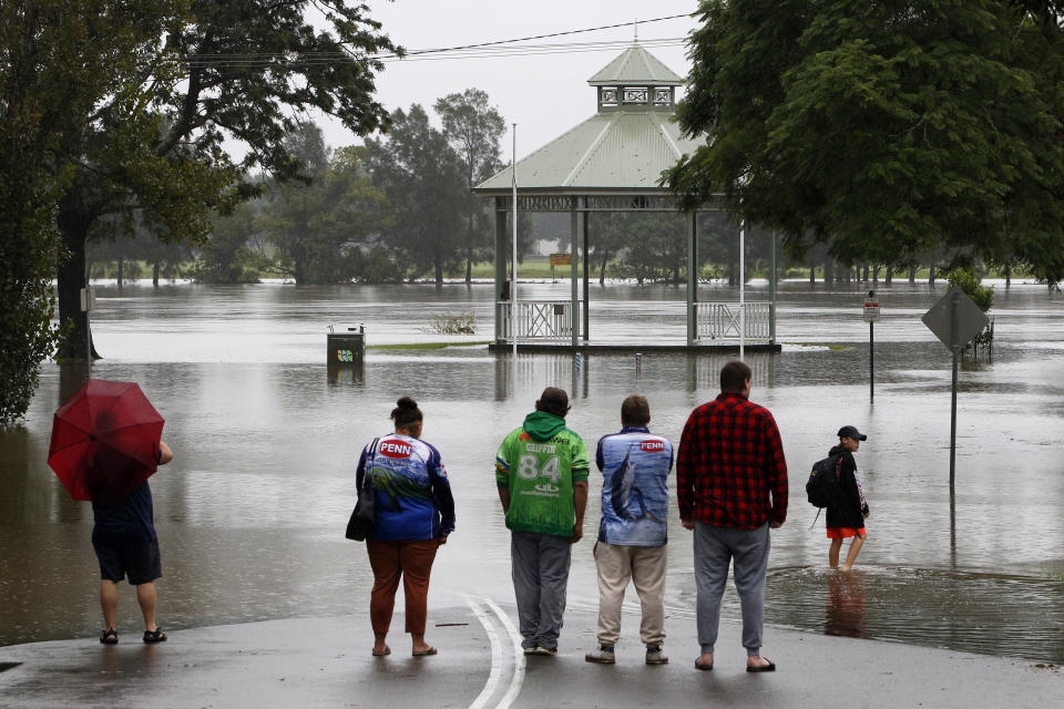 Residents watch rising floodwaters in Raymond Terrace. Source: AAP