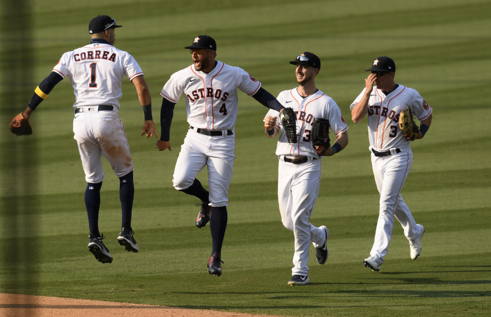 LOS ANGELES, CALIFORNIA - OCTOBER 08: Carlos Correa #1, George Springer #4,  Kyle Tucker #30 and Myles Straw #3 of the Houston Astros celebrate a series win against the Oakland Athletics  in Game Four of the American League Division Series at Dodger Stadium on October 08, 2020 in Los Angeles, California. (Photo by Harry How/Getty Images)