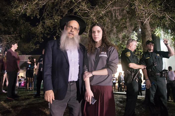 Rabbi Mendy Engel and his daughter, 18-year-old Chaya Itta Engel, came to the vigil to show their support for the families of those who died.
