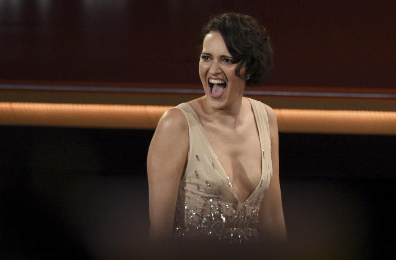 "Phoebe Waller-Bridge reacts in the audience before appearing on stage to accept the award for outstanding lead actress in a comedy series for ""Fleabag"" at the 71st Primetime Emmy Awards on Sunday, Sept. 22, 2019, at the Microsoft Theater in Los Angeles. (Photo by Chris Pizzello/Invision/AP)"