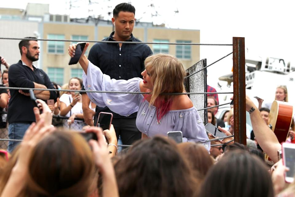 "<div class=""inline-image__caption""><p>Taylor Swift surprises fans on April 25, 2019 in Nashville, Tennessee. </p></div> <div class=""inline-image__credit"">Leah Puttkammer/Getty</div>"