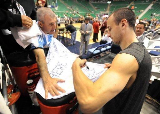 Manu Ginobili of the San Antonio Spurs signs autographs before Game Three of the Western Conference Quarterfinals in the 2012 NBA Playsoffs at EnergySolutions Arena, on May 5, in Salt Lake City, Utah. The Spurs won 102-90, extending the series lead to 3-0