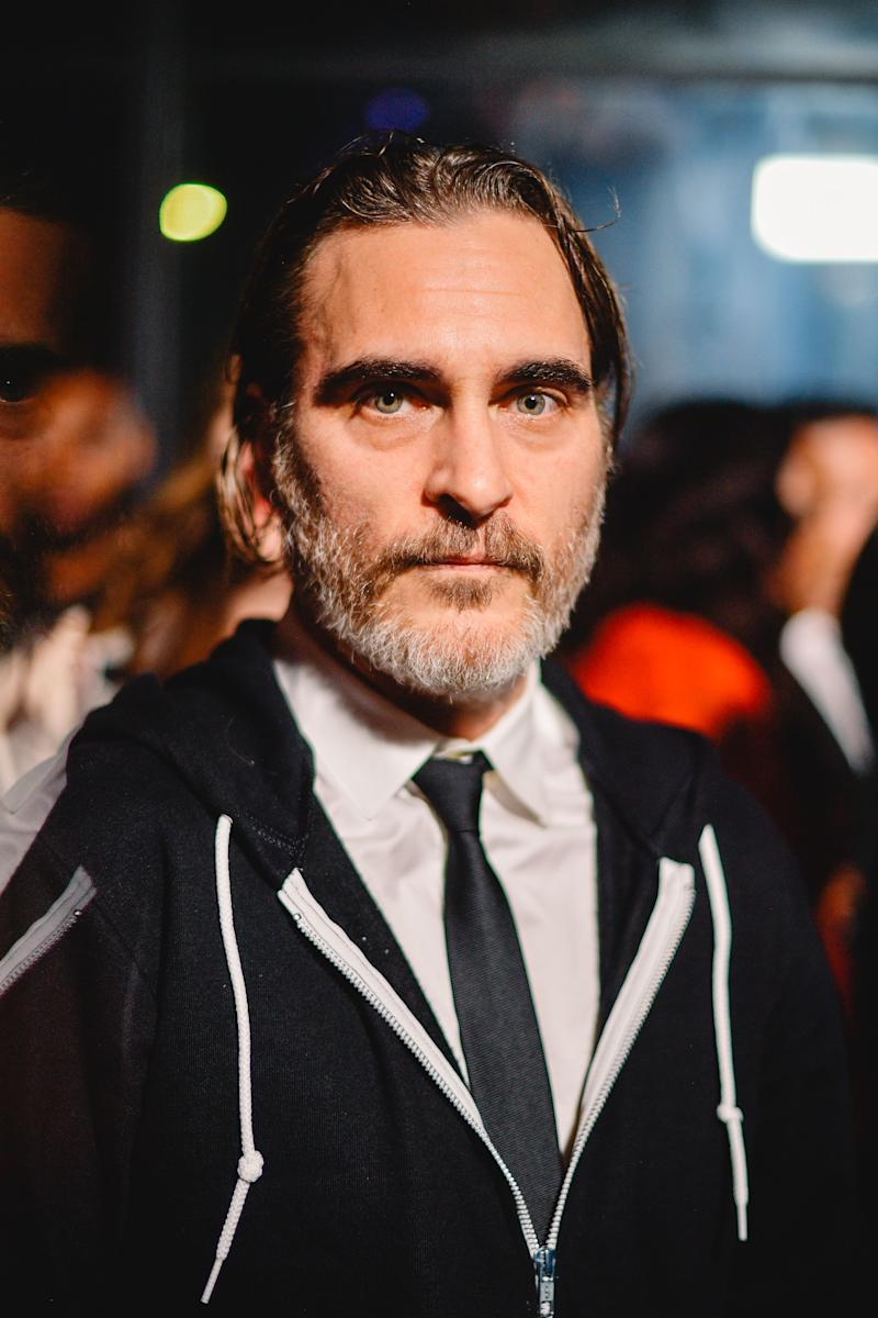 Age has nothing on Joaquin Phoenix as he looks amazing in a T-shirt and tie, with a black sweatshirt.