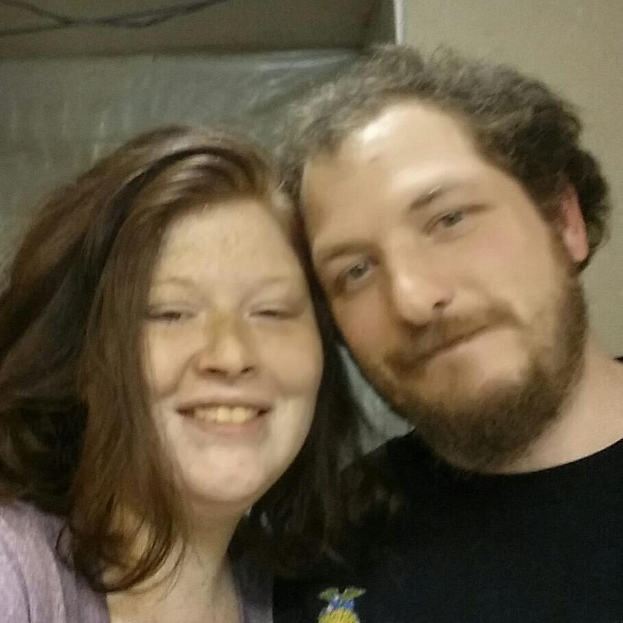 Katie's partner Jason Wall (pictured here with her) also died in the blaze (Picture: Facebook)