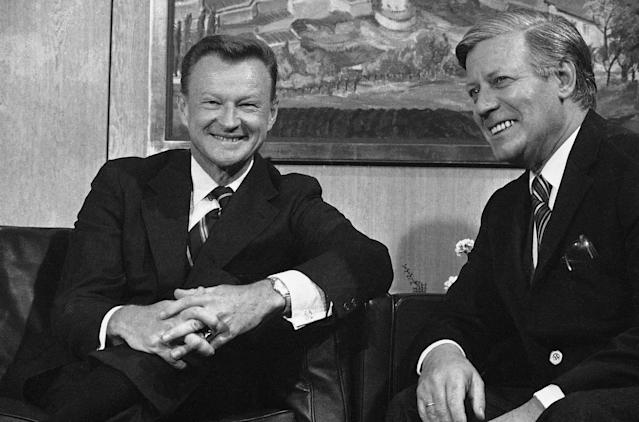 "<p>West German Chancellor Helmut Schmidt, right, responds to newsmen ""I hope you are all in good humor, if not, you can have some of ours,"" prior to his talks with Zbigniew Brzezinski, Pres. Jimmy Carters national security adviser, Tuesday, Oct. 3, 1978, Bonn, Germany. (Photo: Klaus Schlagmann/AP) </p>"