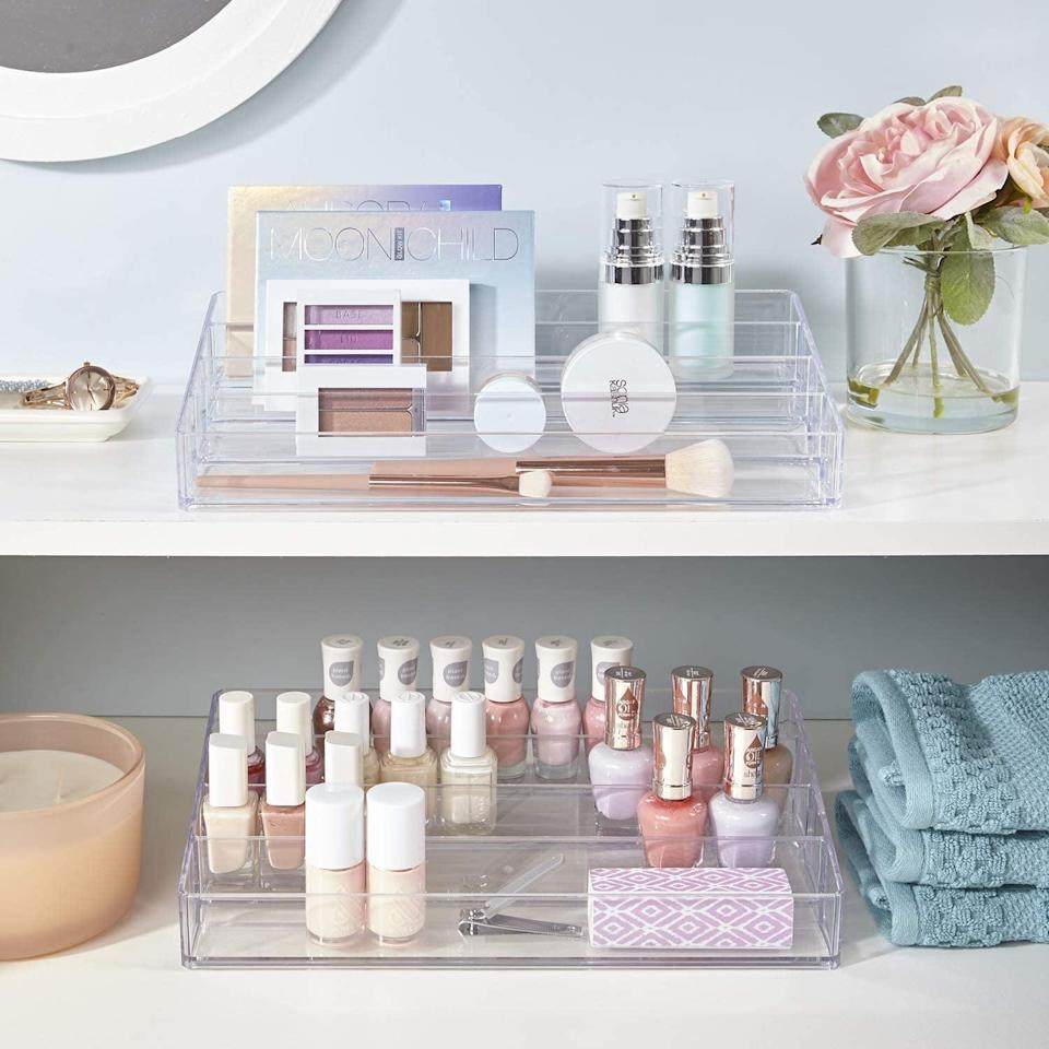 <p>Store more than just nail polish in the <span>Clear Plastic Multi-Level Nail Polish Organizer</span> ($14). The multi-level function lets you be able to properly see all the products you have, from palettes to serums and more. These work great for deeper drawers.</p>